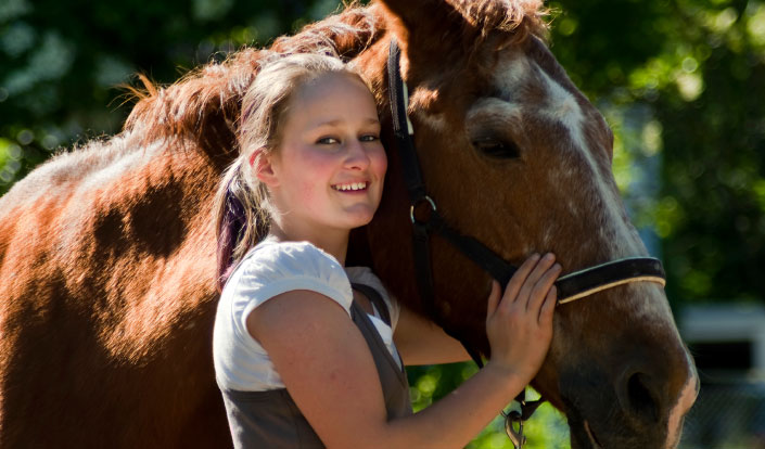 Girl at therapeutic boarding school with horse